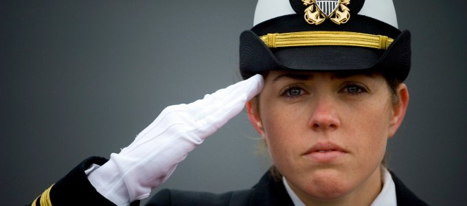 081108-N-5549O-035 MILWAUKEE (Nov. 8, 2008) Ship's Navigator Lt. j.g. Shaina Hayden renders honors to the national anthem during the commissioning ceremony for the littoral combat ship USS Freedom (LCS 1) at Veterans Park in Milwaukee, Wis. Freedom is the first of two littoral combat ships designed to operate in shallow water environments to counter threats in coastal regions. (U. S. Navy photo Mass Communication Specialist 2nd Class Kevin S. O'Brien/Released)