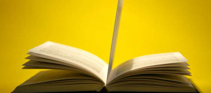 Open book on yellow